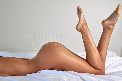 Buy stock photo Cropped shot of an unrecognizable and sexy young woman posing nude in her bedroom