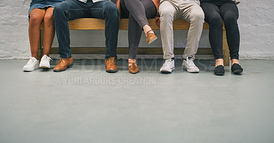 Buy stock photo Cropped shot of a group of businesspeople in the waiting room of a modern office