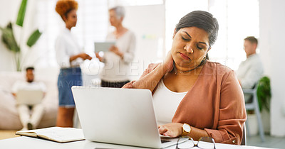 Buy stock photo Shot of a young businesswoman experiencing neck pain while using a laptop in a modern office
