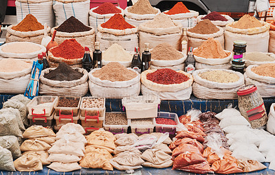 Buy stock photo Shot of a variety of spices displayed at a market