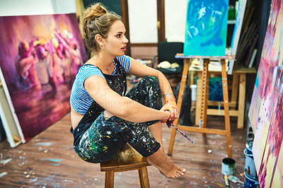 Buy stock photo Full length shot of an attractive young female painter looking at her canvas painting in her art studio