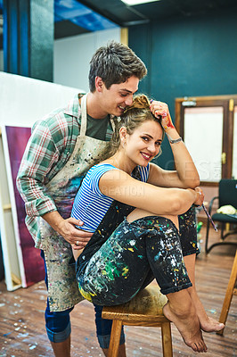 Buy stock photo Cropped shot of an affectionate young female painter sharing a romantic moment with her boyfriend in an art studio