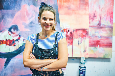 Buy stock photo Cropped portrait of an attractive young woman standing with her arms crossed in her art studio during the day