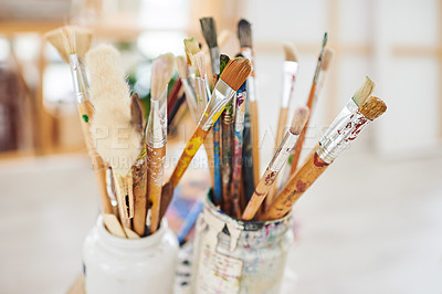 Buy stock photo Still life shot of paintbrushes in jars in a art studio