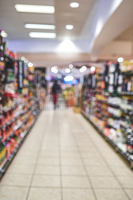 Buy stock photo Blurred shot of a woman shopping in a grocery store