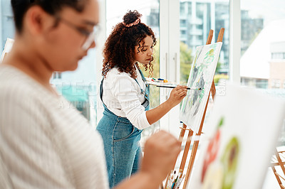 Buy stock photo Cropped shot of an attractive young woman standing with her friend and painting during an art class in the studio