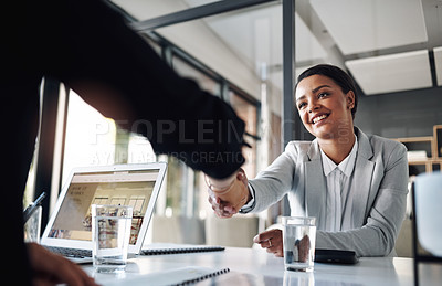 Buy stock photo Cropped shot of an attractive young businesswoman shaking hands with a colleague inside an office