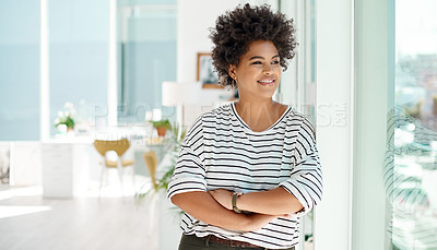 Buy stock photo Shot of a young businesswoman looking thoughtfully out the window in an office