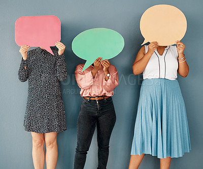 Buy stock photo Studio shot of a group of unrecognizable businesswomen covering their faces with speech bubbles while standing against a grey background