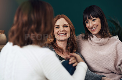 Buy stock photo Cropped shot of three middle aged women having a chat together at home during the day
