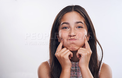 Buy stock photo Cropped portrait of an attractive teenage girl standing alone against a white studio background with her hands to her face