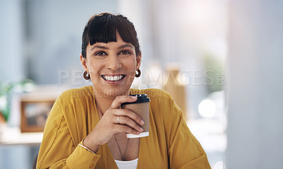 Buy stock photo Cropped portrait of an attractive young businesswoman sitting alone in her office and holding a cup of coffee