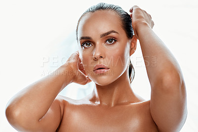 Buy stock photo Shot of a beautiful young woman posing against a white background