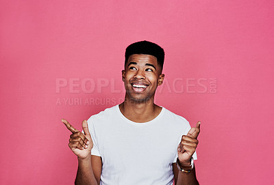 Buy stock photo Cropped shot of a handsome young man standing and making a hand gesture against a pink background in the studio