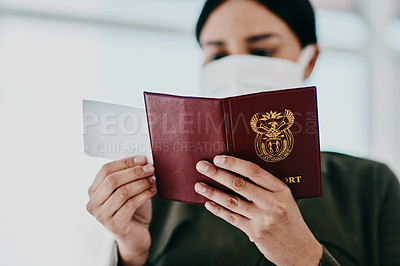 Buy stock photo Cropped shot of a woman holding her passport and boarding pass in an airport