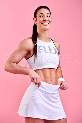 Buy stock photo Studio shot of a sporty young woman posing against a pink background
