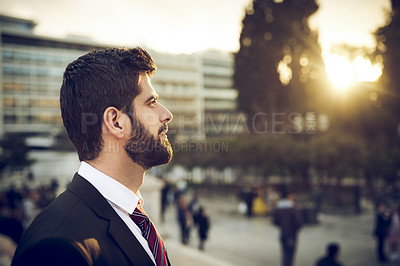 Buy stock photo Cropped shot of a handsome young businessman standing outdoors in a foreign city