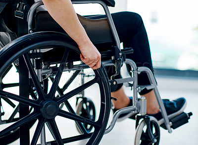 Buy stock photo Cropped shot of an unrecognizable woman sitting in a wheelchair
