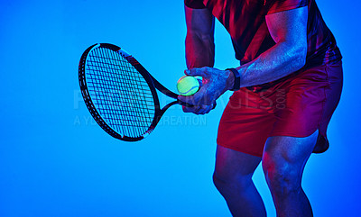 Buy stock photo Blue filtered shot of an unrecognizable tennis player getting ready to serve