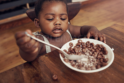 Buy stock photo Cropped shot of an adorable baby girl eating cereal for breakfast at home