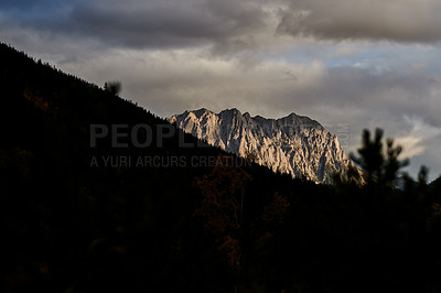 Buy stock photo Shot of beautiful mountain and forest scenery at sunset outdoors in the East Kootenay region in British Columbia, Canada