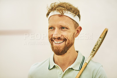 Buy stock photo Shot of a confident young man standing on a squash court