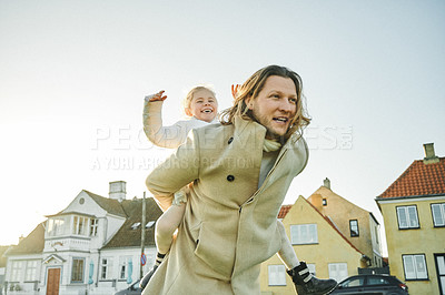 Buy stock photo Shot of an adorable little girl playing and spending time with her father outdoors at a park