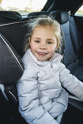 Buy stock photo Portrait of an adorable little girl sitting in her car seat inside of a car