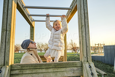 Buy stock photo Cropped shot of an adorable little girl playing with her father at a park outdoors