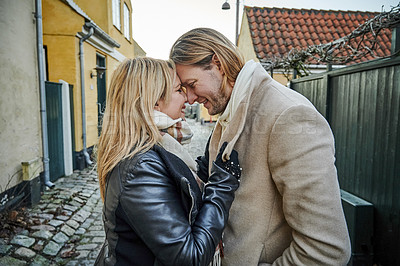 Buy stock photo Cropped shot of an affectionate young couple embracing outdoors while traveling together in a foreign town