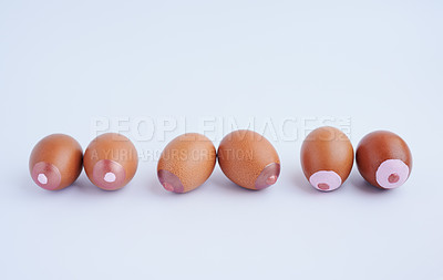 Buy stock photo Studio shot of painted eggs against a plain background