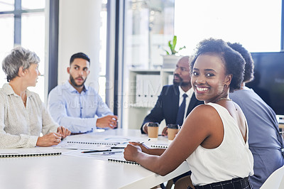 Buy stock photo Portrait of an attractive young businessman attending a meeting with her colleagues inside a boardroom