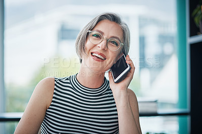 Buy stock photo Cropped shot of a mature businesswoman talking on her cellphone