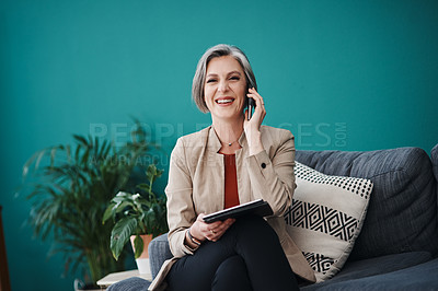Buy stock photo Cropped portrait of an attractive mature businesswoman sitting alone and using technology in her home office