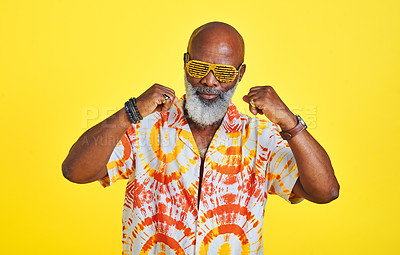Buy stock photo Cropped shot of a funky and stylish senior man dancing in studio against a yellow background