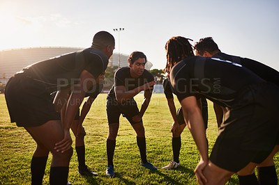 Buy stock photo Cropped shot of a diverse group of sportsmen huddled together before playing a game of rugby