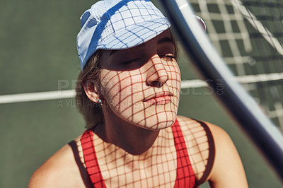 Buy stock photo Cropped shot of an attractive young sportswoman standing alone and posing on a tennis court during the day