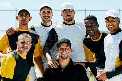 Buy stock photo Cropped portrait of a team of handsome young baseball players smiling while standing on  the field during the day