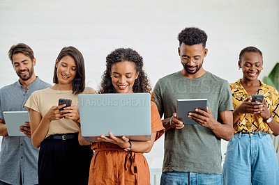 Buy stock photo Shot of a group of businesspeople using digital devices in an office
