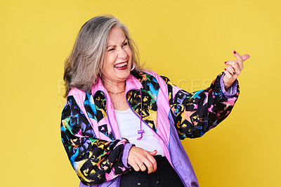 Buy stock photo Cropped shot of a cheerful and stylish senior woman posing against a yellow background