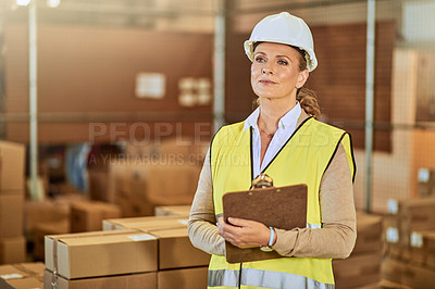 Buy stock photo Cropped shot of an attractive mature supervisor wearing a safety helmet and vest during a stocktake in a warehouse
