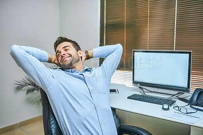 Buy stock photo Cropped shot of a businessman looking laid-back while sitting in his office