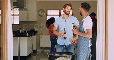 Buy stock photo Shot of two young friends having beers during a barbecue at home
