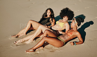 Buy stock photo Full length shot of a young group of female friends bonding together during an enjoyable day on the beach