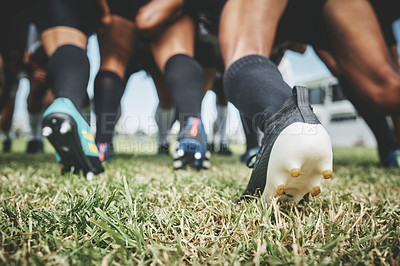 Buy stock photo Low angle shot of two unrecognizable rugby teams competing in a scrum during a rugby match on a field