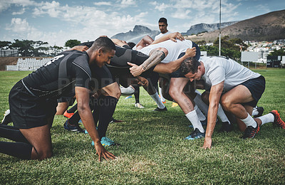 Buy stock photo Cropped shot of two young rugby teams competing in a scrum during a rugby match on a field