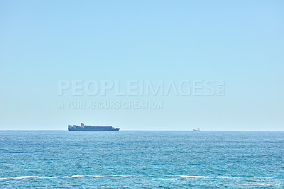Buy stock photo Cargo ship on calm sea at midday