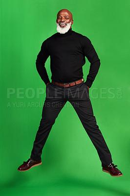 Buy stock photo Studio shot of a senior man posing against a green background