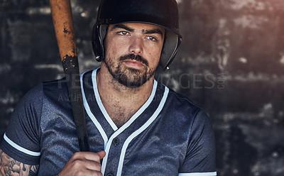 Buy stock photo Shot of a young man holding his bat at a baseball game