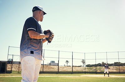 Buy stock photo Shot of a young man pitching a ball during a baseball match